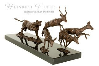 Wildlife Bronze Sculpture by Heinrich Filter titled: Hot pursuit, lioness in pursuit of antelopes, created in 2013