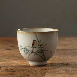 Guangyu Li: 'bird whisper', 2019 Handbuilt Ceramics, Animals. Handmade porcelain teacup, hand- painted scene of a bird on bamboo. It s a traditional style of Song dynasty literati painting, showing a great taste of Chinese traditional culture. ...