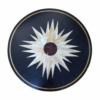 Surendra Rajput: 'the 24 pointed star', 2020 Marble Sculpture, Geometric. The 24 Pointed Star -This is the perfect geometrical art piece, made on Black Natural Indian Marble slab of round shape. The black marble is carved and inlaid with a 24 pointed star made of Tiger Eye Semi Precious Stone. Center circle of the star is made of Italian Stone. ...