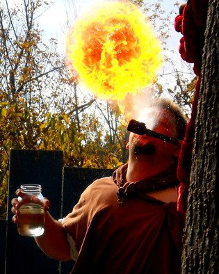 Artist: Jeanette Locher - Title: Fire eater - Medium: Color Photograph - Year: 2013