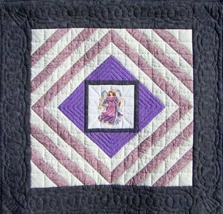 Jean Judd: 'Purple Angel', 2004 Textile Art, Representational.  Part of my ongoing series featuring hand cross stitched center medallions.  Hand quilted and hand bound.Artwork is accompanied by a Certificate of Authenticity signed by the artist.Exhibition History - - Mixed Sampler Quilt Guild Show, Siren Wisconsin, September 30- October 1, 2006.- - Juried into the Sacred Threads 2007 quilt show...