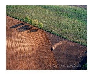 Color Photograph by John Griebsch titled: Field, Tractor, and Four Trees near Brutus, New York, USA, created in 2008
