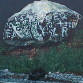 Rock with Grafitti and Tire