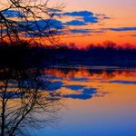 Cloud Reflections at Sunrise By Mark Goodhew