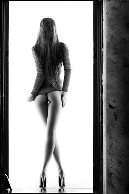 Johan Swanepoel: 'woman standing in doorway', 2019 Black and White Photograph, Nudes. Artist Description: Erotic body of a woman with long hair in lingerie standing with high- heels in a doorway against a white background. Sensual fine art photography of the female buttocks, rear body  and legs...