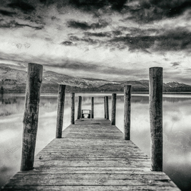 Jonathan O'hora: 'derwent water', 2017 Black and White Photograph, Landscape. Artist Description: Photography: Black   White and Digital on Paper.Derwent Water, view from jetty at dusk.Archival Print 20 x 13. 5  Limited edition of 50 photographic prints. Each print is made from Kodak Metallic Paper with an archival quality of 75 years.Derwentwater  or Derwent Water  is one of ...
