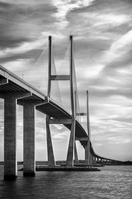 Jon Glaser: 'Lanier Bridge at Sunset II', 2016 Black and White Photograph, Landscape.  While in south Georgia, near Jekyll Island, this photograph showed the leading lines on the Sydney Lanier Bridge. This limited- edition photograph, measuring approximately 16x24, is printed on fade- resistant Museo Silver Rag paper that has no optical brighteners. The image has been varnished with a protective coating that protects...