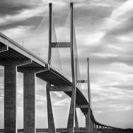 Jon Glaser: 'Lanier Bridge at Sunset II', 2016 Black and White Photograph, Landscape. Artist Description:  While in south Georgia, near Jekyll Island, this photograph showed the leading lines on the Sydney Lanier Bridge. This limited- edition photograph, measuring approximately 16x24, is printed on fade- resistant Museo Silver Rag paper that has no optical brighteners. The image has been varnished with a protective coating ...