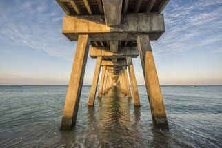 Jon Glaser: 'Venice Below the Pier', 2015 Color Photograph, Landscape. Artist Description:  This pier was located in Venice, Florida. I photographed this in the morning just as the sun was coming up.* This Limited edition photograph measures approximately 40x60 and is ready to hang. It comes mounted and varnished in a white wood frame. The varnish protects the print from ...