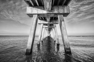 Jon Glaser: 'Venice Below the Pier II', 2014 Black and White Photograph, Landscape.  This pier was located in Venice, Florida. I photographed this in the morning just as the sun was coming up.This limited- edition photograph, measuring approximately 16x24, is printed on fade- resistant Museo Silver Rag paper that has no optical brighteners. The image has been varnished with a protective coating...