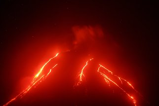 Alexander Piragis: 'Night view of eruption volcano', 2019 Color Photograph, Landscape. Artist Description: Volcanic landscape of Kamchatka night view of eruption Klyuchevskaya Sopka, current lava flows on the slope of the volcano.  Russian Far East, Kamchatka Region, Klyuchevskaya Group of Volcanoes. ...