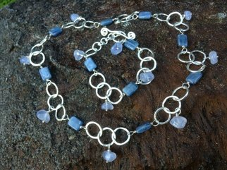 Lisa Schaffer-doggett: 'Blue Kyanite and Chalcedony Necklace Bracelet Set', 2014 Jewelry, undecided. Artist Description:  Blue Kyanite and Chalcedony Necklace and Bracelet set with handmade hammered Fine Silver Circles, Spiral Toggle Clasp.  All made by me in my garden studio.  ...