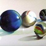 Glass balls with man By Camilo Lucarini