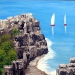 Sailboats near Cliffs By Lora Vannoord