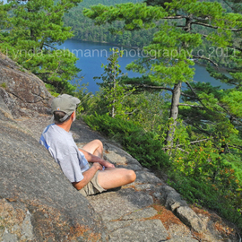 Lynda Lehmann: 'Awesome View', 2011 Color Photograph, Beauty. Artist Description:  Hiker perched on a ledge over scenic and beautiful Echo Lake in Acadia National Park, contemplates the scene in a special moment of solitude and peace.  Keywords: lake, land, trail, rocks, peace, trees, perch, light, woods, ledge, arbor, pines, vista, maine, alone, solace, hiking, travel, acadia, forest, lonely, ...