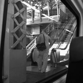 Lynda Lehmann: 'Exiting', 2006 Other Photography, Zeitgeist. Artist Description:  Exiting the train into a maze of steel and reflective surfaces.  Matted archival print.  Image c Lynda Lehmann.   ...