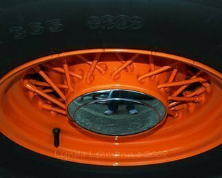 Color Photograph by Lynda Lehmann titled: Painted Wheel, created in 2008