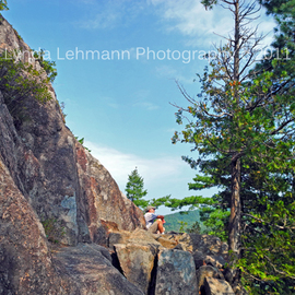 Lynda Lehmann: 'Perched Over Echo Lake', 2011 Color Photograph, Beauty. Artist Description:  Hiker perched on a ledge over scenic and beautiful Echo Lake in Acadia National Park.  Keywords: Acadia, Maine, Northeast, National Park, nature, beauty, scenic, landscape, texture, tourism, travel, recreation,  inspiration, hiking, climbing, trail, lake, ledge, boulders, rocks, perch, precarious, forest, woods, arbor, trees, beautiful, height, solace, lonely, solitude, ...