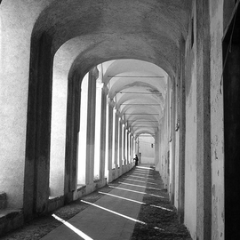 Lynda Lehmann: 'The Monastery Within', 2005 Black and White Photograph, World Culture. Artist Description:  Fading into the distance, the arches of the monastery at Imperia Vecchia seem to connote the passage of time. The tiny figure staring out at the far end might symbolize the smallness ( or perhaps the significance) of the individual, in the stream of human history.  Image c Lynda ...