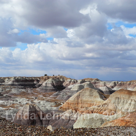 Lynda Lehmann: 'The Sky Clears by Blue Mesa', 2012 Color Photograph, Landscape. Artist Description:  After a raw, gray day of wind- blown showers and flurries, the afternoon sky cleared and shone a beautiful light on the hills by Blue Mesa, in Painted Desert National Park.