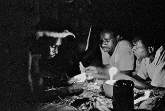 Michael Prochnik: 'Game of Cards ', 1995 Black and White Photograph, People. Artist Description:  Irian Jaya. Young tribal men play cards in there hut to a candle light          ...