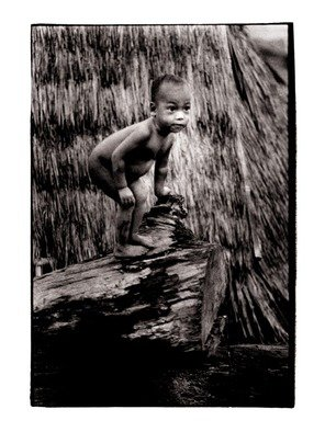 Michael Prochnik: 'My Tree stump', 1992 Black and White Photograph, People. Artist Description:  A Thai kid playing on a tree stump outside his hut in his village  ...