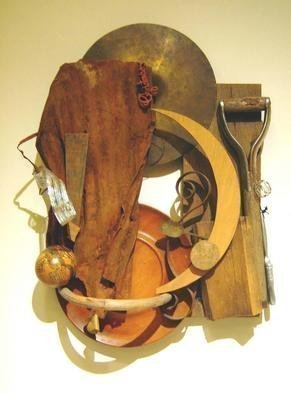 Ron Ogle: 'Shield', 1999 Assemblage, Americana. An assemblage made of wood and metal objects mostly found in Rusty' s back yard- where I lived in a school bus in which I burned seasoned hickory when the snow fell, and later. I have been embellishing   this assemblage for 21 years....
