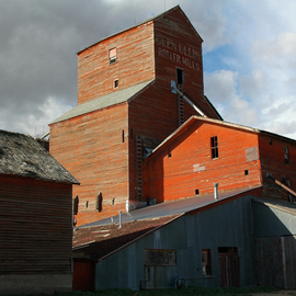 Obert Fittje: 'Glen Ullen Mills', 2006 Color Photograph, Architecture. Artist Description:  This is a photo of an abandoned rolling mill in the northern plains with an almost abstract form made by the walls and roofs.  On one side the sky is cloudy and gray and on the other, light and heavenly clouds. ...