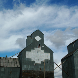 Obert Fittje: 'Old Peavey Elevator', 2005 Color Photograph, Sky. Artist Description:  My uncle Ted Netland worked for Peavey Elevators and helped build many such grain elevators.  The diamond had the letters
