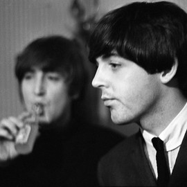 Paul Berriff: 'Fade Out', 1964 Black and White Photograph, Music. Artist Description:  John Lennon sips a lemonade as he and Paul McCartney take a few moments to relax before their concert at the Odeon Theater Leeds England on 22 October 1964.  This is a limited edition and comes signed on the verso by the photographer Paul Berriff with limited edition ...
