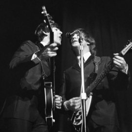 Paul Berriff: 'Harmony', 1963 Black and White Photograph, Music. Artist Description: John Lennon and Paul McCartney during the first ever performance of I Want To Hold Your Hand at the ABC Theater in Huddersfield England. This is a limited edition and comes signed on the verso by the photographer Paul Berriff with limited edition number and authenticity certificate. The ...