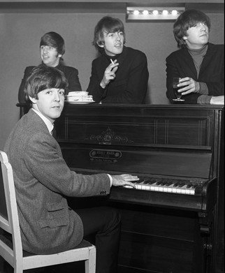 Paul Berriff: 'Piano Time', 1963 Black and White Photograph, Music. Artist Description:  The Beatles enjoy time around a piano in their dressing room at the Gaumont Theater in Bradford Yorkshire England before appearing on stage for their Christmas Concert on 21 December 1963. The photograph comes signed on the verso by the photographer Paul Berriff with limited edition number and ...