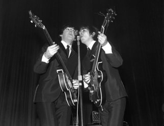 Paul Berriff: 'Reflections', 1963 Black and White Photograph, Music.  Paul McCaartney and George Harrison Share the microphone on stage at the ABC Theater Huddersfield England on 29 November 1963 during The Beatles first UK tour.  This is a limited edition and comes signed on the verso by the photographer Paul Berriff with limited edition number and authenticity certificate.  The...