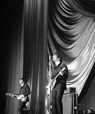 Paul Berriff: 'Showtime', 1963 Black and White Photograph, Music.   John Lennon and Paul McCartney on stage at the Gaumont Theater in Bradford England on the 21 December 1963 during The Beatles Christmas Show. This is a limited edition and comes signed on the verso by the photographer Paul Berriff with limited edition number and authenticity certificate. The image is...