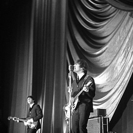 Paul Berriff: 'Showtime', 1963 Black and White Photograph, Music. Artist Description:   John Lennon and Paul McCartney on stage at the Gaumont Theater in Bradford England on the 21 December 1963 during The Beatles Christmas Show. This is a limited edition and comes signed on the verso by the photographer Paul Berriff with limited edition number and authenticity certificate. The ...