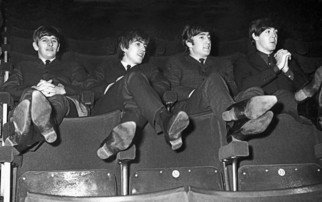 Paul Berriff: 'The Beatles Kicking Back', 1963 Black and White Photograph, Music. Artist Description:  The Beatles relax in the auditorium at the ABC Theater in Huddersfield Yorkshire on 29 November 1963. This was The Beatles first tour of the UK. Limited Edition and comes signed on the verso by photographer Paul Berriff with limited edition number and authenticity certificate. The photograph is ...