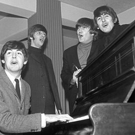 Paul Berriff: 'The Beatles The Chorus', 1963 Black and White Photograph, Music. Artist Description:  The Beatles enjoy a sing song around a piano in their dressing room at the Gaumont Theater in Bradford Yorkshire England before their Christmas concert on 21 December 1963.  This is a limited edition and is signed on the verso by photographer Paul Berriff with limited edition number ...
