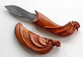 Pavel Sorokin: 'Argus dagger in scabbard', 2015 Woodworking Art, Fantasy. Artist Description: this decorative knife is from my WOODIUS collection of gifts made of carved tropical wood. Handle and scabbard made of rose wood with small fantasy image. Blade is made of damascus steel...