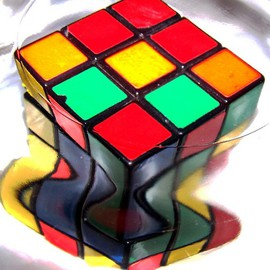 C. A. Hoffman: 'Rubix Meltdown', 2008 Color Photograph, Abstract. Artist Description:  This photo is part of my Wormhole series.  It shows what can happen when an ordinary object like a rubix cube gets swallowed by a wormhole and begins to