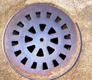 Photography by C. A. Hoffman titled: Utilities Rain Drain, created in 2008