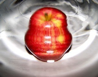 Color Photograph by C. A. Hoffman titled: Wormhole Apple II, 2008