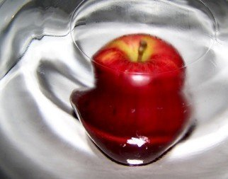 Color Photograph by C. A. Hoffman titled: Wormhole Apple III, 2008