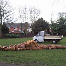 Robot Cossey: 'Dragon', 2009 Wood Sculpture, Landscape. Artist Description:  Commissioned by Dudley Council for a children's play area in Brook Street just outside Stourbridge town centre.Joint project, designed by Steve Field, carved by myself and wood sculptor Graham Jones.Carved from Oak, the Dragon is approximately 8 metres in length.   ...