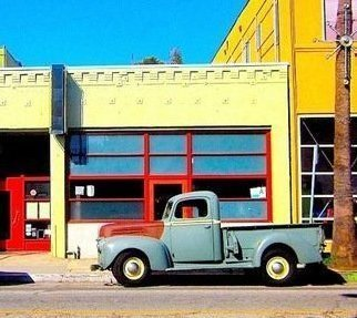 Ronnie Caplan: 'Abbott Kinney Truck', 2014 Color Photograph, Automotive.   This fat fendered classic Ford pickup truck sits beautifully positioned along Abbot Kinney Blvd in Venice, California. It's light gray- blue color, offset with the rust hood and yellow rim tires give it a classic, lazy feel and look. It is situated in front of a deserted storefront with...