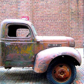 Ronnie Caplan: 'Truckin', 2014 Color Photograph, Automotive. Artist Description: A retro, antique feeling emanates from this semi- dilapidated truck, parked on a field of cobblestones, as if fixed in time.  .  .  Antiquated and enduring, the vehicle still stands bold against a brick wall in an almost monochromatic composition that features dulcet hues of brown, ochre, rust, ash.  .  .  ...