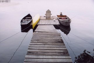 Ruth Zachary: 'Away From It All', 2004 Color Photograph, Boating.  Summer at the lake.  Canoes, the back of an old Adirondack chair on wooden dock. Tranquility, nostalgia. Belgrade Lakes, Maine.  11 x 14