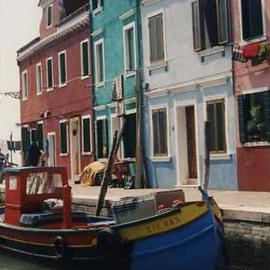 Ruth Zachary: 'Colors of Burano II', 1997 Color Photograph, Boating. Artist Description: Island of Burano, Venice, Italy.  Famous for its hand- made lace and its colorful charm. Whimical little boat dressed- up in red, yellow and blue.  Backed by homes decked out in rose, turquoise and lavendar. Variety of geometric shapes contrast with the wonderful curve of the boat.  Limited ...