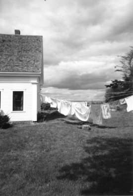 Ruth Zachary: 'Laundry Day Rain Coming', 2012 Black and White Photograph, Landscape. Laundry on the line, traditional New England cottage looking out to sea, billowy cloud bank threatening rain.  ...