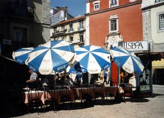 Ruth Zachary: 'Umbrellas of Lisbon', 1996 Color Photograph, Travel.  Cheerful, charming row of umbrellas. Charming street scene. Take a seat and order a coffee. People- watch. Interesting lines and colorful contrast.  Lisbon, Portugal.  5 x 7 in an 11 x 14 acid free mat. Signed and titled. Larger size available.  Enjoy! ...