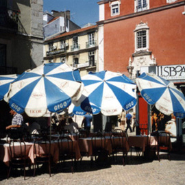 Ruth Zachary: 'Umbrellas of Lisbon', 1996 Color Photograph, Travel. Artist Description:  Cheerful, charming row of umbrellas. Charming street scene. Take a seat and order a coffee. People- watch. Interesting lines and colorful contrast.  Lisbon, Portugal.  5 x 7 in an 11 x 14 acid free mat. Signed and titled. Larger size available.  Enjoy! ...